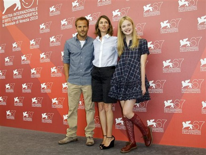 From left actor Stephen Dorff, director Sofia Coppola, and actress Elle Fanning pose during a photo call for the movie Somewhere at the 67th edition of the Venice Film Festival in Venice, Italy, Friday, Sept. 3, 2010. (AP Photo/Joel Ryan)