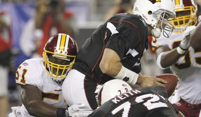 ASSOCIATED PRESS Washington Redskins' Robert Henson, left, sacks Arizona Cardinals quarterback Matt Leinart, top, in the first quarter in a preseason NFL football game Thursday, Sept. 2, 2010, in Glendale, Ariz.