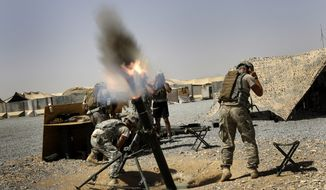 U.S. soldiers of the Fort Campbell based 1-75 Cavalry fire 122 mm mortars at a nearby Taliban position at Forward Operating Base Wilson in Kandahar Province, Southern Afghanistan, Saturday, Sept. 4, 2010. (AP Photo/ Todd Pitman)