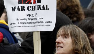 A protester demonstrates outside Eason book store in Dublin, Ireland, Saturday, Sept. 4, 2010. Former British Prime Minister Tony Blair appeared for a public book signing at the Eason book store as anti-war protesters hurled shoes and eggs at him as he arrived for his first public signing of his fast-selling memoir. (AP Photo/Peter Morrison)