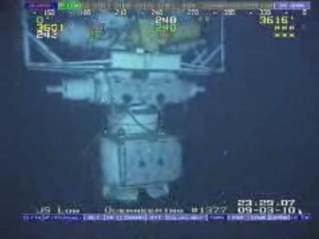 This image taken from video provided by BP PLC shows the blowout preventer that failed to stop oil from spewing into the Gulf of Mexico being raised to the surface. (AP Photo/BP PLC)