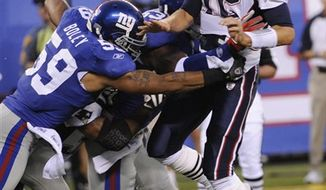New England Patriots' Tom Brady, right, is hit by New York Giants' Michael Boley and Keith Bulluck  during the first quarter of an NFL preseason football game at New Meadowlands Stadium in East Rutherford, N.J., Thursday, Sept. 2, 2010.  (AP Photo/Bill Kostroun)