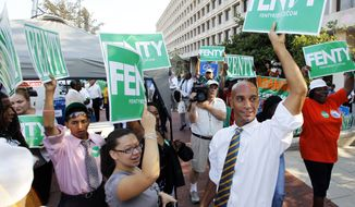 Washington Mayor Adrian Fenty, right, joins his campaigners outside a Washington polling center, during an early voting Monday, Aug. 30, 2010. Early voting for the September primary election in Washington began Monday with a number of changes for voters, including new voting machines that create a paper record and more lenient registration procedures. (AP Photo/Manuel Balce Ceneta)