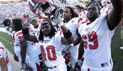 Jacksonville State quarterback Coty Blanchard, left, and defensive back Brooks Robinson (14) celebrate the team's 49-48 double-overtime victory over Mississippi in an NCAA college football game in Oxford, Miss., Saturday, Sept. 4, 2010. (AP Photo/Rogelio V. Solis)