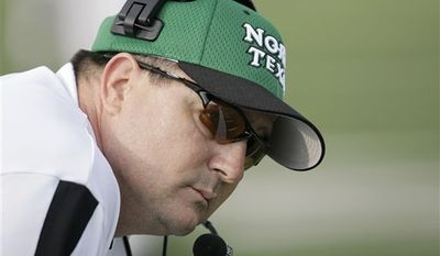 FILE - In this Nov. 10, 2007, file photo, North Texas head coach Todd Dodge looks on during an NCAA college football game against Navy in Denton, Texas.  Dodge is no longer the hot shot high school coach hired to energize the North Texas football program. After 31 losses in three years, he's just trying to hang on to his job and avoid becoming another case study in why it's so rare for a coach to be plucked from the preps and put in charge of a major college team.  (AP Photo/Matt Slocum, File)