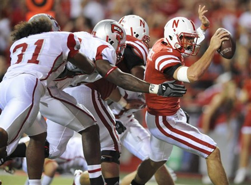 Western Kentucky's Willie McNeal (86) carries the ball against Nebraska's Cameron Meredith in the first half of an NCAA college football game in Lincoln, Neb., Saturday, Sept. 4, 2010. (AP Photo/Dave Weaver)