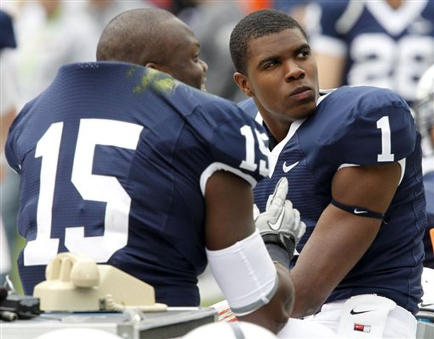 Penn State quarterback Robert Bolden (1) and teammate Bani Gbadyu (15) sit out the fourth quarter of an NCAA college football game against Youngstown State in State College, Pa., Saturday, Sept. 4, 2010. Bolden played three quarters of the 44-14 Penn State win. (Associated Press) **FILE**