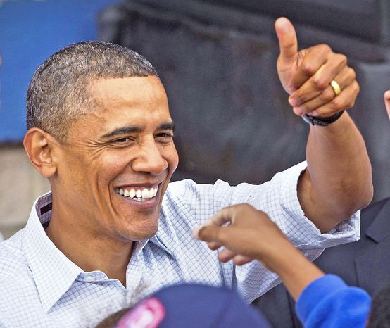"ASSOCIATED PRESS PHOTOGRAPHS  President Barack Obama rallies the crowd Monday in Milwaukee, where he proposed more spending to create jobs and berated the GOP as the ""party of no."""