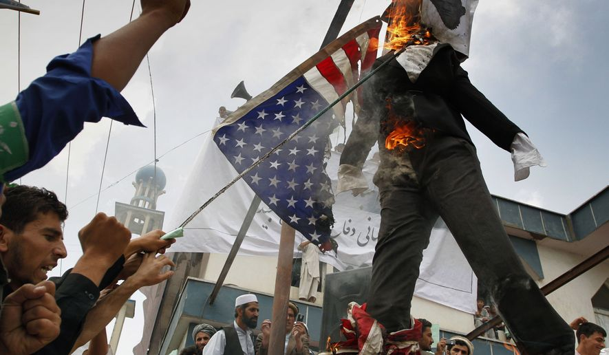 Afghans burn an effigy of the Rev. Terry Jones, the pastor of the Dove World Outreach Center, during a demonstration Monday in Kabul. Hundreds of Afghans railed against the U.S. and called for President Obama's death at a rally in the capital to denounce the American church's plans to burn copies of the Koran on Sept. 11. (Associated Press)