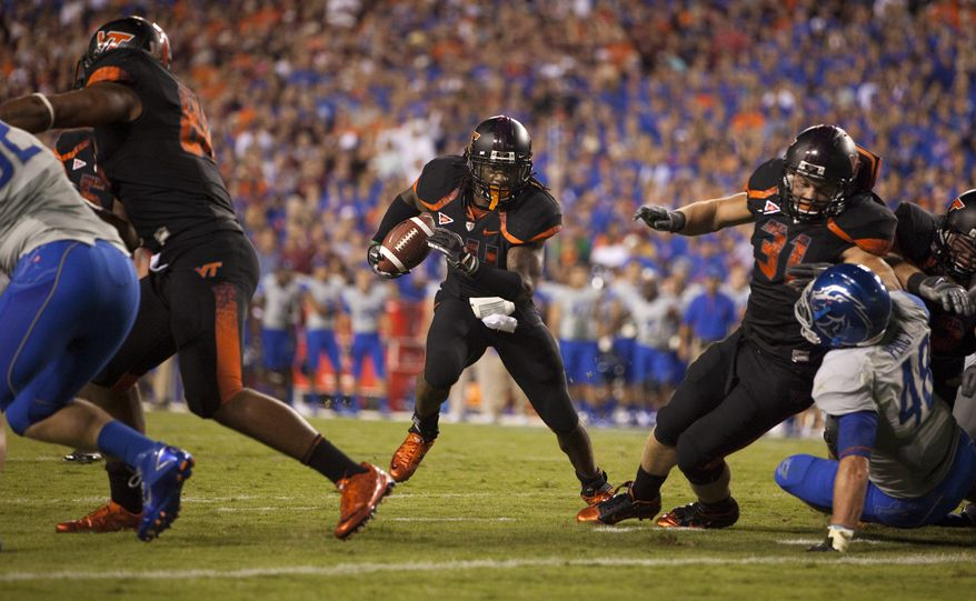 ASSOCIATED PRESS Virginia Tech running back Ryan Williams (34), center, runs for a touchdown during the first quarter of an NCAA college football game against Boise State on Monday, Sept. 6, 2010 in Landover, Md. From left, Boise State defensive end Shea McClellin (92), Virginia Tech tight end Andre Smith (88), Williams, Virginia Tech fullback Kenny Younger (31), and Boise State linebacker J.C. Percy (48).