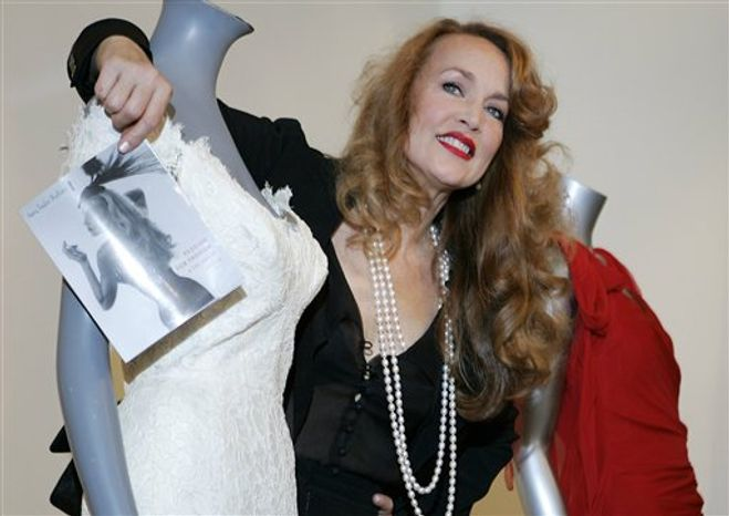 "FILE - This is a Monday June 9, 2008 file photo of American actress and former supermodel Jerry Hall as she  stands next to her wedding dress, which she wore for her 1990 marriage to Rolling Stone front man Mick Jagger,  during a photocall to launch the 'Passion For Fashion & Fine Textiles' auction, in London.  Hall plans to auction some of her art collection next month, including a famous portrait by Lucian Freud that shows her nude when she was eight months pregnant, Sotheby's said Monday Sept 6, 2010. Sotheby's specialist Oliver Barker said the Lucian Freud portrait called ""Eight Months Gone"" is the centerpiece of the auction and is expected to fetch more than 300,000 pounds (US$460,000). (  (AP Photo/Alastair Grant, File)"