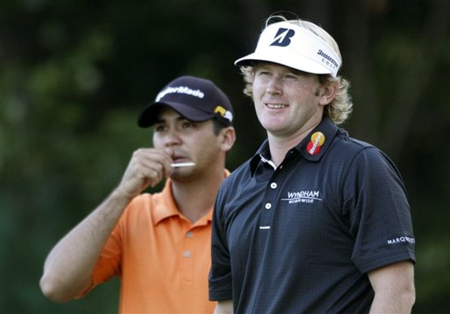 Tiger Woods, right, discusses the eighth hole with his caddie Steve Williams during the third round at the Deutsche Bank Championship golf tournament at TPC Boston in Norton, Mass., Sunday, Sept. 5, 2010. (AP Photo/Stew Milne)