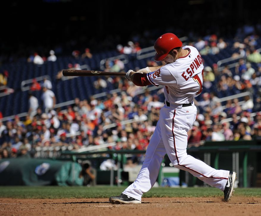 ASSOCIATED PRESS Washington Nationals' Danny Espinosa follows through on his grand slam home run during the sixth inning of a baseball game against the New York Mets, Monday, Sept. 6, 2010, in Washington.