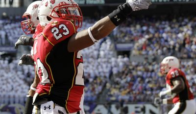 ASSOCIATED PRESS Maryland running back Da'Rel Scott (23) celebrates after scoring a touchdown against Navy during the first half of an NCAA college football game, Monday, Sept. 6, 2010, in Baltimore.
