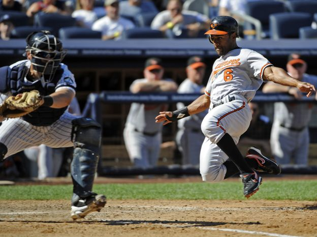 ASSOCIATED PRESS Baltimore Orioles' Corey Patterson, right, scores on a single by Brian Roberts as New York Yankees catcher Francisco Cervelli takes the throw during the seventh inning of a baseball game Monday, Sept. 6, 2010 at Yankee Stadium in New York.