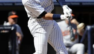 New York Yankees' Alex Rodriguez hits a home run during the fourth inning of a baseball game against the Baltimore Orioles Monday, Sept. 6, 2010 at Yankee Stadium in New York. (AP Photo/Bill Kostroun)