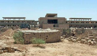 """A prison construction project north of Baghdad shows no signs of being completed any time soon, and the inspector general says, """"It will never hold a single Iraqi prisoner."""" (Associated Press)"""