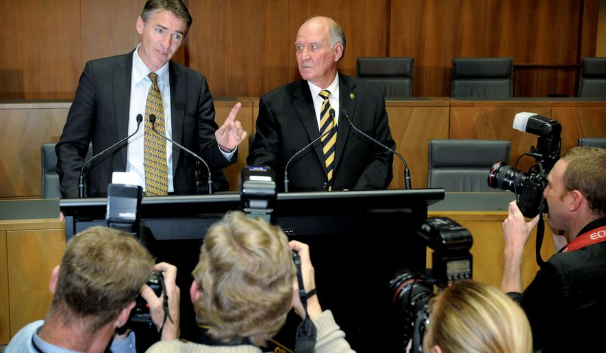 Australian independent lawmaker Rob Oakeshott speaks Tuesday as fellow independent Tony Windsor listens during a press conference in Canberra. Prime Minister Julia Gillard's Labor Party gained the ability to form a government after the two independent lawmakers joined her coalition. (Associated Press)