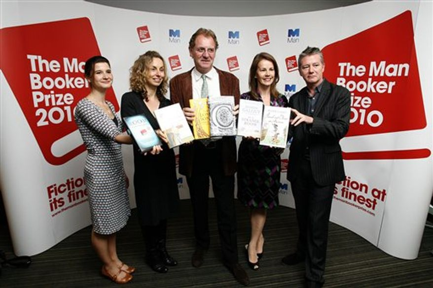 Judges, from left, Rosie Blau, Literary Editor of the Financial Times, Frances Wilson, writer, Chair Andrew Motion, Professor of Creative Writing at Royal Holloway College, Deborah Bull, Creative Director of the Royal Opera House, and Tom Sutcliffe, author, broadcaster and journalist, pose for photographers with short listed books during a press conference for the 2010 Man Booker Prize for Fiction in London, Tuesday, Sept. 7, 2010. The judges have Tuesday announced the short listed books, which are Peter Carey 'Parrot and Olivier in America', Emma Donoghue 'Room', Damon Galgut 'In a Strange Room', Howard Jacobson 'The Finkler Question', Andrea Levy 'The Long Song', and Tom McCarthy 'C'.(AP Photo/Akira Suemori)