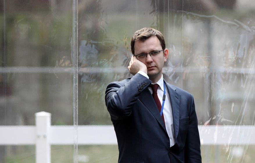 ** FILE ** Andy Coulson, the director of communications for Britain's Conservative Party, speaks on the phone at Battersea Power Station following the launch of his party's manifesto in London in April 2010. (AP Photo/Oli Scarff, Pool)