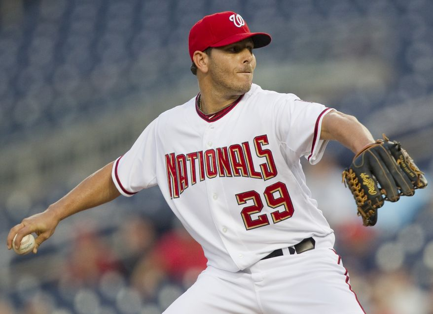 ASSOCIATED PRESS Washington Nationals starting pitcher Yunesky Maya throws his first pitch in his debut in the majors, during a baseball game against the New York Mets on Tuesday, Sept. 7, 2010, in Washington.