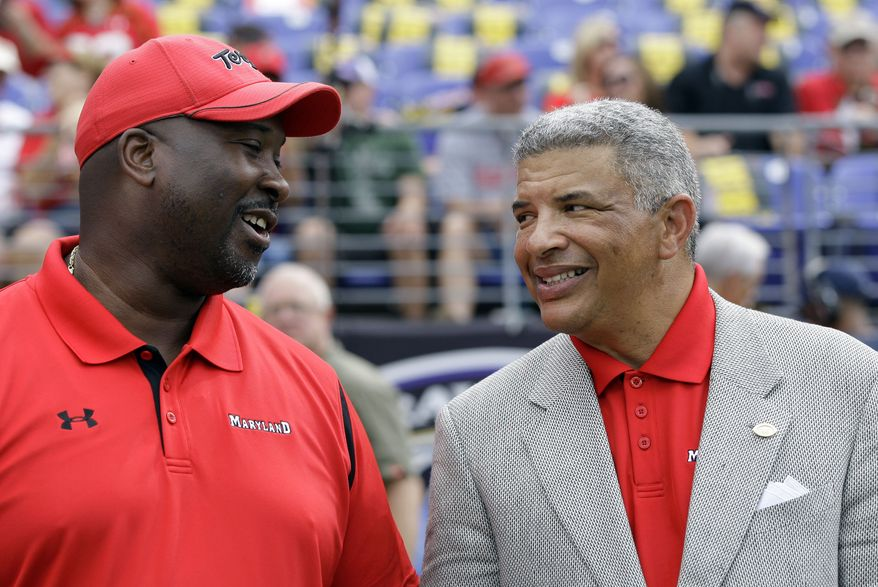 ASSOCIATED PRESS Maryland athletics employee Kevin Glover, left, talks with  athletic director Kevin Anderson, right, before the start of of an NCAA college football game between Maryland and Navy, Monday, Sept. 6, 2010, in Baltimore.