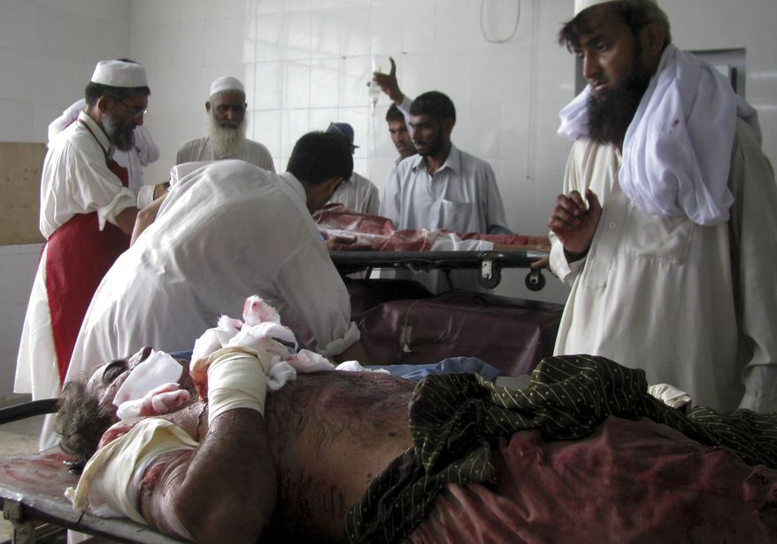 Injured victims of a suicide bombing are treated at a local hospital in Bannu, Pakistan, on Monday, Sept. 6, 2010. A suicide bomber detonated a car in an alley behind a police station in a strategically vital town in northwest Pakistan, killing scores of police and civilians in an explosion that shattered the station and neighboring homes, police said. (AP Photo/Ijaz Mohammad)