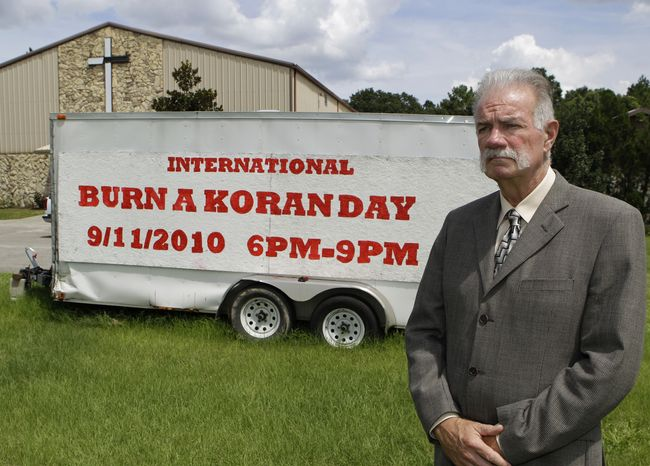 UP IN FLAMES: The Rev. Terry Jones at the Dove World Outreach Center in Gainesville, Fla., plans to burn copies of the Koran to mark the anniversary of Sept. 11 terrorist attacks. (Associated Press)
