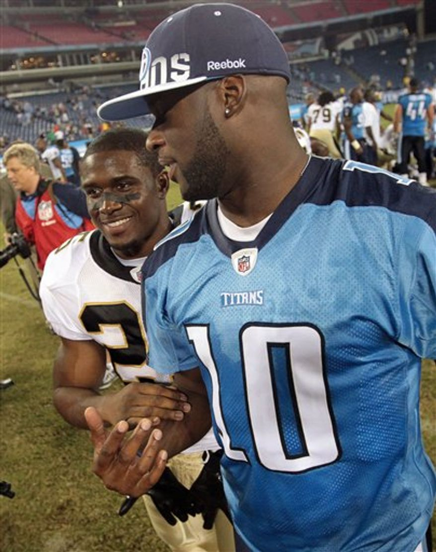 New Orleans Saints running back Reggie Bush, left, talks with Tennessee Titans quarterback Vince Young following an NFL preseason football game in Nashville, Tenn., Thursday, Sept. 2, 2010. The Titans won 27-24. (AP Photo/Dave Martin)