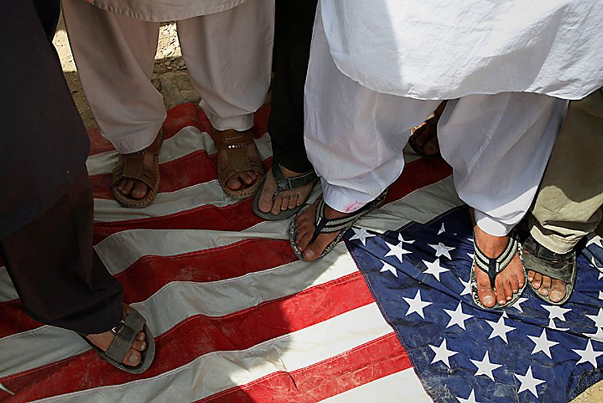 Afghan protesters step on a U.S. flag during a demonstration against the United States, in Kabul, Afghanistan, Monday, Sept. 6, 2010. Hundreds of Afghans railed against the U.S. and called for President Barack Obama's death at a rally in the capital Monday to denounce an American church's plans to burn the Islamic holy book on 9/11. (AP Photo/Musadeq Sadeq)