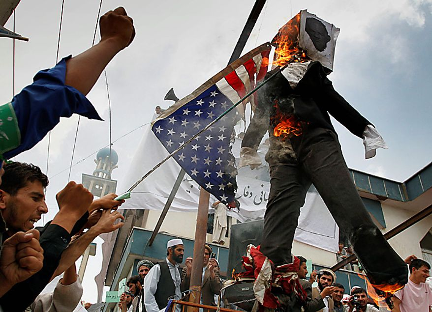 Afghans burn an effigy of Dove World Outreach Center's pastor Terry Jones during a demonstration against the United States in Kabul, Afghanistan, Monday, Sept. 6, 2010. Hundreds of Afghans railed against the U.S. and called for President Barack Obama's death at a rally in the capital Monday to denounce the American church's plans to burn the Islamic holy book on 9/11. (AP Photo/Musadeq Sadeq)