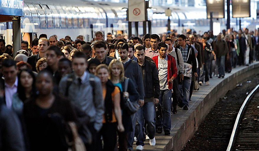 Commuters leave a suburban train at the Saint Lazare railway station in Paris, Tuesday, Sept. 7, 2010. French unions launched a major strike Tuesday over unpopular conservative President Nicolas Sarkozy's plans to raise the retirement age from 60 to 62, with walkouts causing headaches for travelers and commuters. (AP Photo/Thibault Camus)