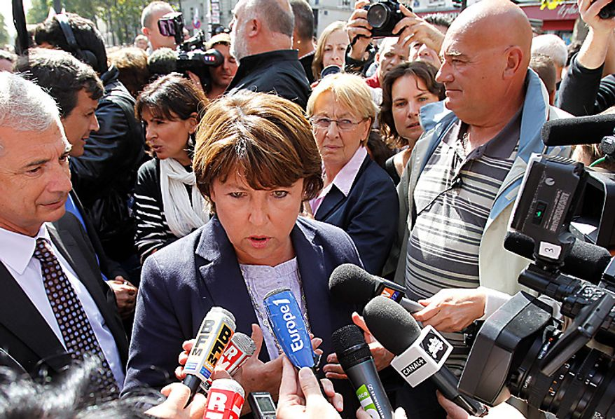 French Socialist Party secretary general Martine Aubry answers reporters during a demonstration Tuesday Sept. 7, 2010 in Paris. French unions challenged unpopular President Nicolas Sarkozy with a major nationwide strike over plans to raise the retirement age from 60 to 62, cutting service on trains, planes, buses and subways. (AP Photo/Christophe Ena)