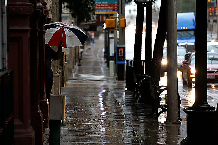 A pedestrian holds an umbrella in downtown San Antonio, Texas Tuesday Sept. 7, 2010 as Tropical Storm Hermine dumps rains in the area. Numerous Central Texas counties remain under a flash flood watch until midnight Tuesday according to the National Weather Service. Two to 5 inches of rain are expected to fall in the area. (AP Photo/San Antonio Express-News, Jerry Lara)