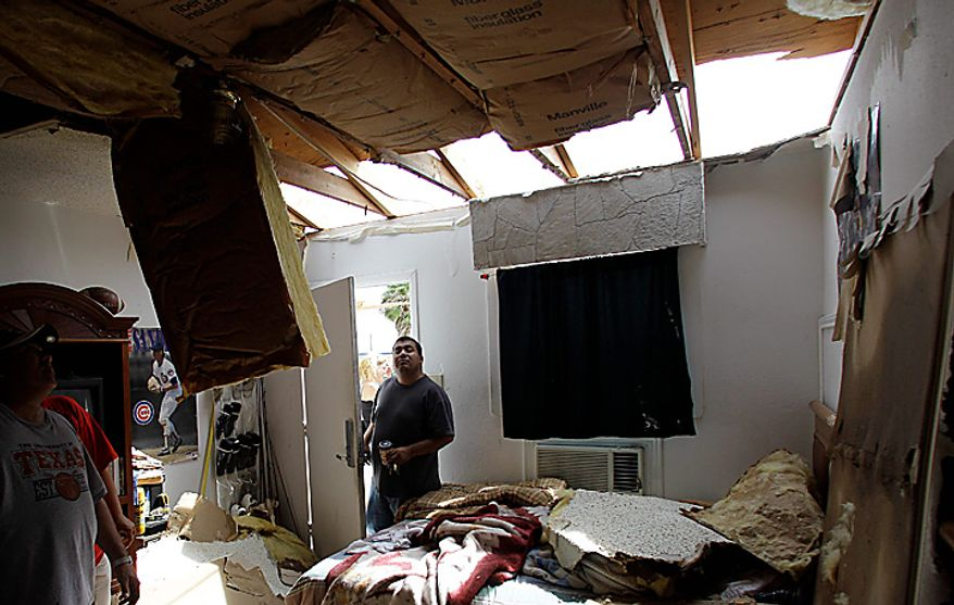 Manager Juan Cortez surveys a room at his motel, Tuesday, Sept. 7, 2010 in Raymondville, Texas. The motel lost a portion of its roof when tropical storm Hermine swept through the area. (AP Photo/Eric Gay)