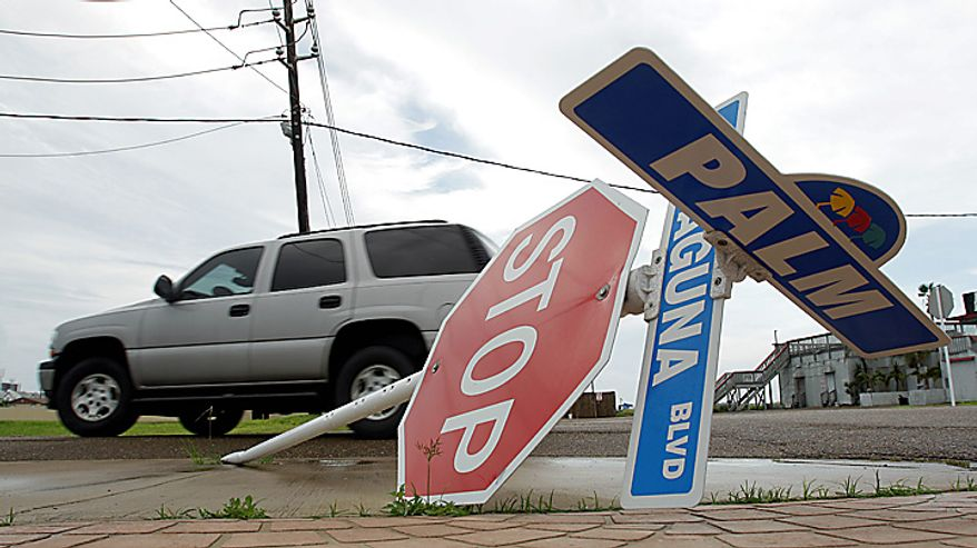 A car passes by a stop sign, Tuesday, Sept. 7, 2010 in South Padre Island, Texas, after tropical storm Hermine swept through the area. (AP Photo/Eric Gay)