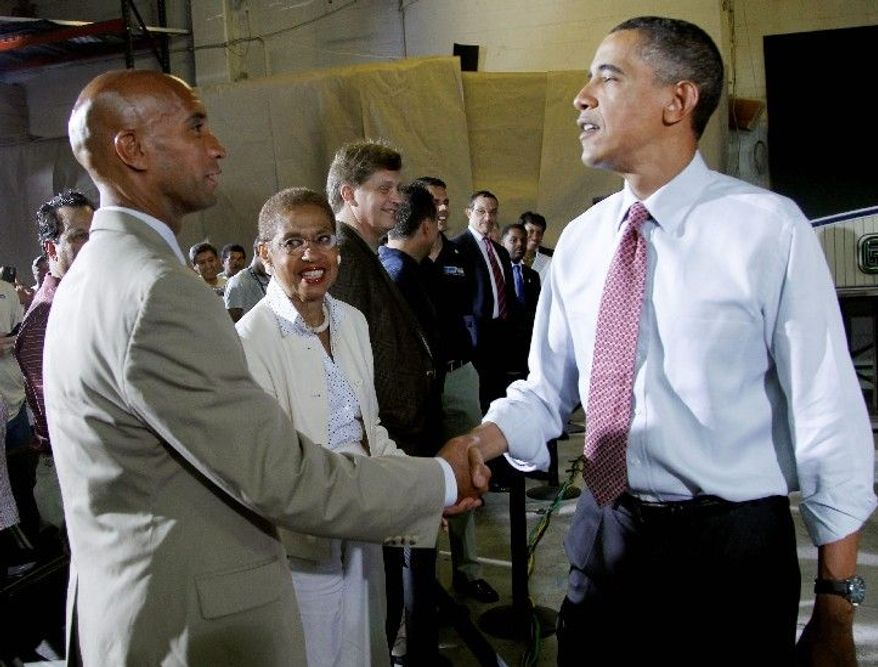 ASSOCIATED PRESS District Mayor Adrian M. Fenty, with D.C. Delegate Eleanor Holmes Norton, greets President Obama Aug. 6 after a presidential address in the city. Mr. Fenty says he wants the president's endorsement.