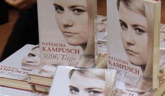 The book '3096 Tage' (3096 days) by Natascha Kampusch, who was kidnapped and imprisoned in a cellar for eight and a half years, are on display in a book shop as the sale of the book starts in Vienna, Austria, Tuesday, Sept. 7, 2010.  (AP Photo/Ronald Zak)