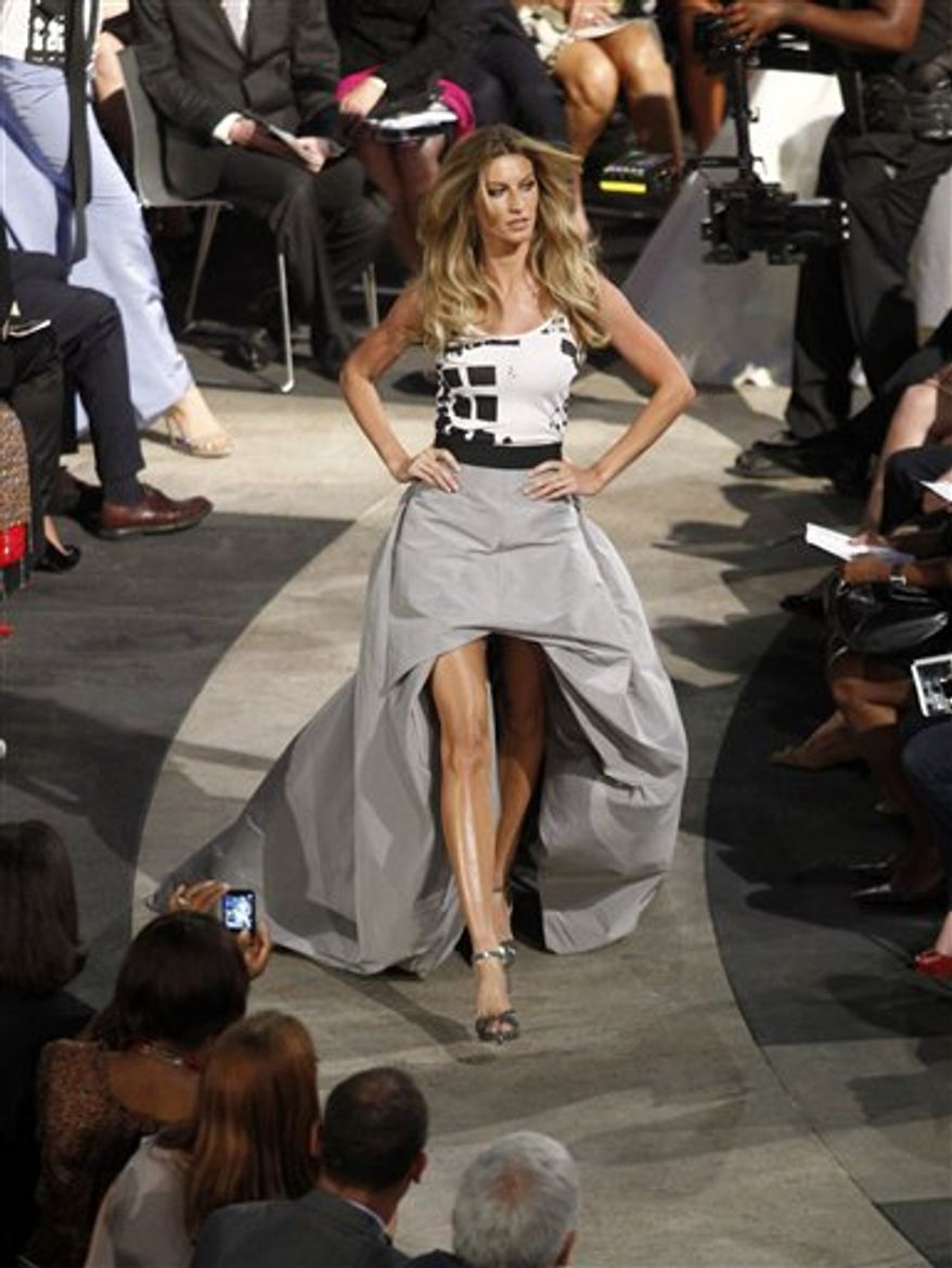"Model Gisele Bundchen walks the runway during ""Fashion's Night Out: The Show"" at Lincoln Center in New York on Tuesday, Sept. 7, 2010. (AP Photo/Peter Kramer)"