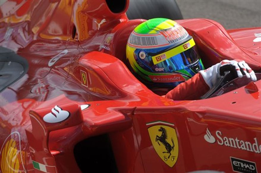 Formula One driver Felipe Massa of Brazil prepares to drive his 2009 Ferrari during a show at the Hungaroring circuit in Mogyorod, northeast of Budapest, Hungary, Sunday, Sept. 5, 2010. (AP Photo/MTI, Imre Foeldi)