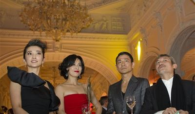 From left, actors Li Bingbing, Carina Lau, Andy Lau and director Tsui Hark attend during a reception for the film Di Renjie Zhi Tongtian Diguo (Detective Dee and the Mystery of Phantom Flame) at the 67th edition of the Venice Film Festival in Venice, Italy, Monday, Sept. 6, 2010. (AP Photo/Domenico Stinellis)
