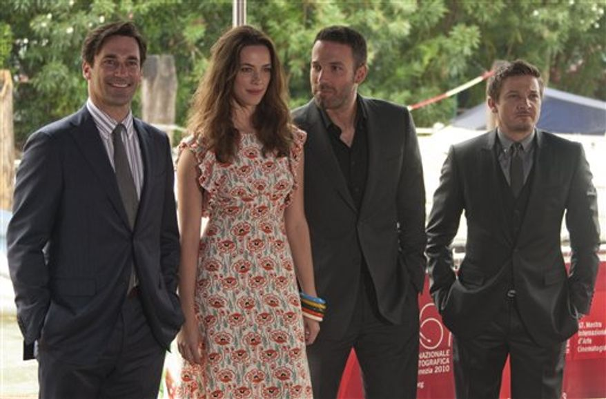 Actors Jon Hamm and Rebecca Hall share a joke as they arrive for the press conference of the film The Town at the 67th edition of the Venice Film Festival in Venice, Italy, Wednesday, Sept. 8, 2010. (AP Photo/Joel Ryan)