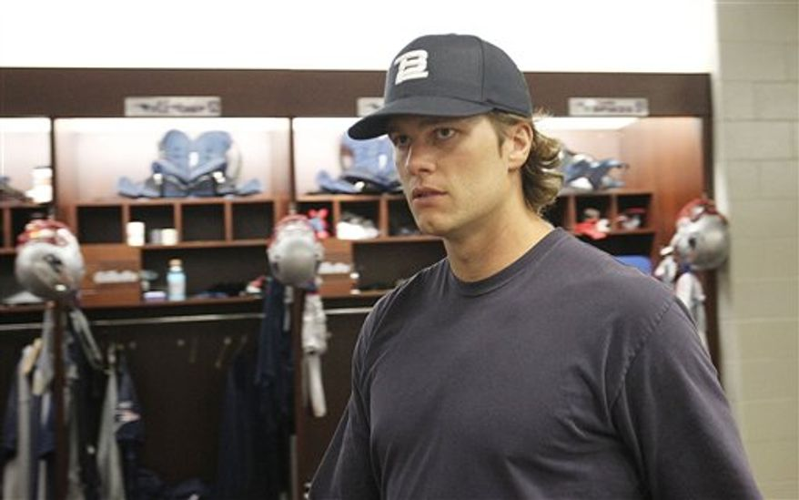 New England Patriots quarterback Tom Brady walks through the locker room before a media availability at the NFL football team's facility in Foxborough, Mass., Wednesday morning, Sept. 8, 2010. (AP Photo/Stephan Savoia)