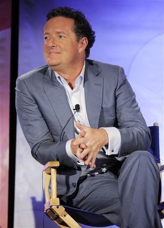 """FILE - In this April 26, 2010 file photo, Piers Morgan, a judge on the NBC show """"America's Got Talent,"""" participates in a panel discussion during the NBC Universal 2010 Summer Press Day in Pasadena, Calif. (AP Photo/Chris Pizzello, file)"""