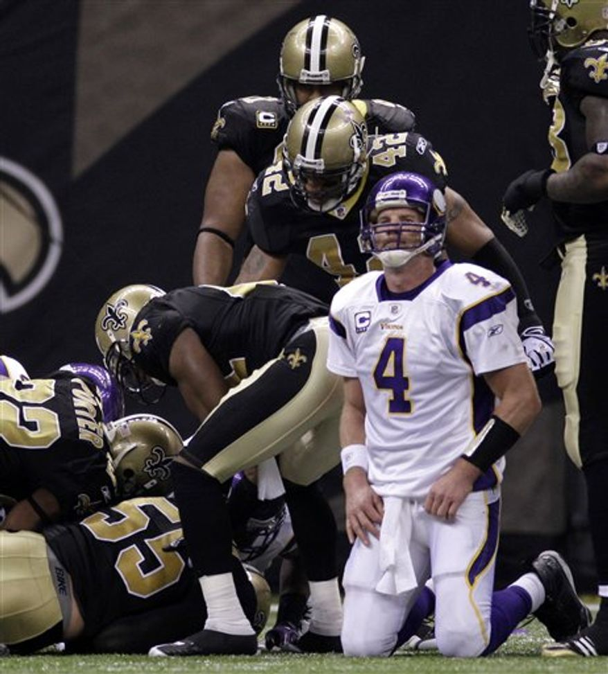 FILE - This Jan. 24, 2010, file photo shows Minnesota Vikings quarterback Brett Favre (4) reacting after fumbling the ball,  which was recovered by the New Orleans Saints during the second quarter of the NFC Championship NFL football game in New Orleans. The Vikings were left to stew over their loss until this Thursday night, when the NFL's season kicks off with a rematch of one of the most riveting games played last season. (AP Photo/Mark Humphrey, File)
