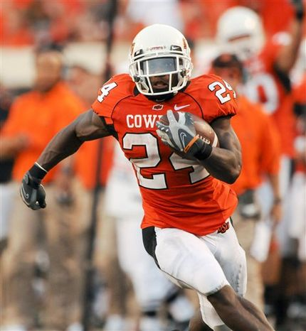 Oklahoma State running back Kendall Hunter breaks away for a 66-yard run during the first half of an NCAA college football game against Washington State in Stillwater, Okla.. Saturday, Sept. 04, 2010.(AP Photo/Brody Schmidt)