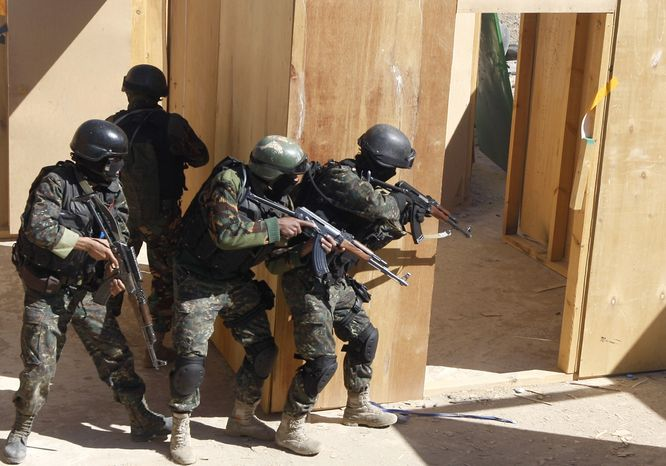 ** FILE ** In this Saturday, Jan. 9, 2010, file photo, soldiers from the anti-terrorism force of the Yemeni Defense Ministry take part in an exercise at a training camp at the Sarif district, north of the capital San'a, Yemen. U.S. special operations forces are expanding their training of the Yemeni military as the Obama administration broadens its program to counter terrorism in countries reluctant to harbor a visible American military presence. (AP Photo/Nasser Nasser, File)