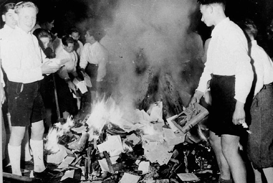 Members of the Hitler Youth are shown burning books in Salzburg, Austria, on April 30, 1938. (Associated Press)