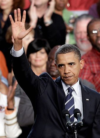 President Barack Obama waves after speaking about the economy,Wednesday, Sept. 8, 2010, at Cuyahoga Community College in Parma, Ohio. (AP Photo/Tony Dejak)