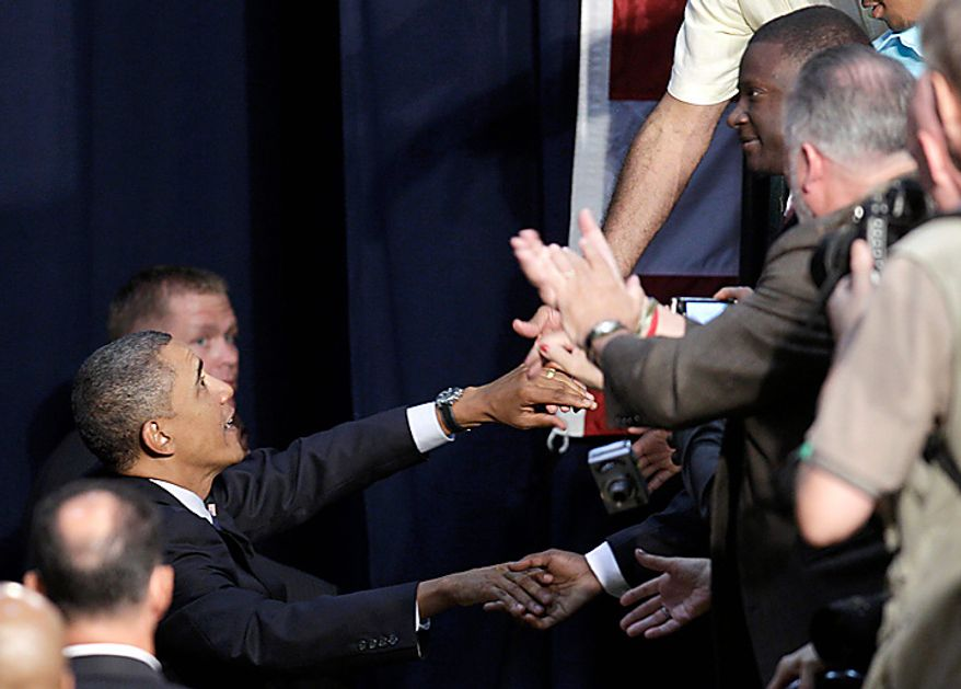 President Barack Obama shakes hands after speaking about the economy,Wednesday, Sept. 8, 2010, at Cuyahoga Community College in Parma, Ohio. (AP Photo/Tony Dejak)